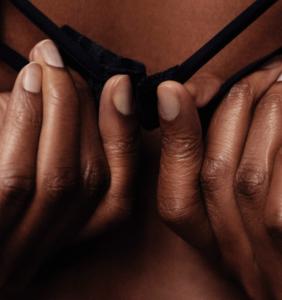 woman detaching her bra