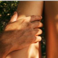 man on woman's body outside